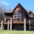 OUTSTANDING CUSTOM BUILT NEWER CHALET ON SECLUDED SETTING ON 20 PRIVATE ACRES. 1 MILE TO SLOPES AT HOLIMONT. HOME OFFERS 6 BEDROOMS, 3 & HALF BATHS W/ TWO SEPERATE LIVING AREAS.